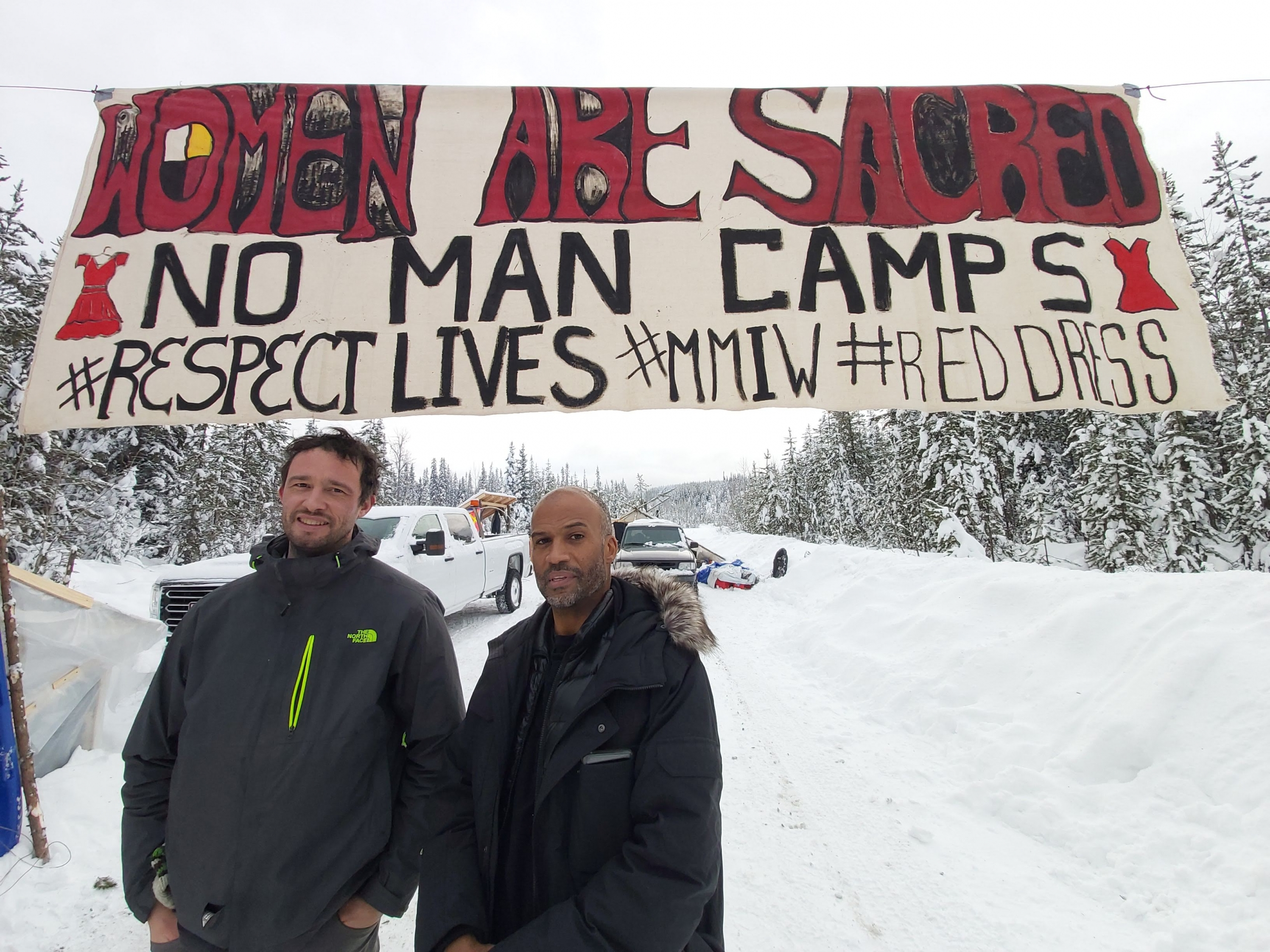 Noah with Carl Williams at the kilometre 39 camp which was dismantled by RCMP on February 6, 2020 (Photo by Jerome Turner)